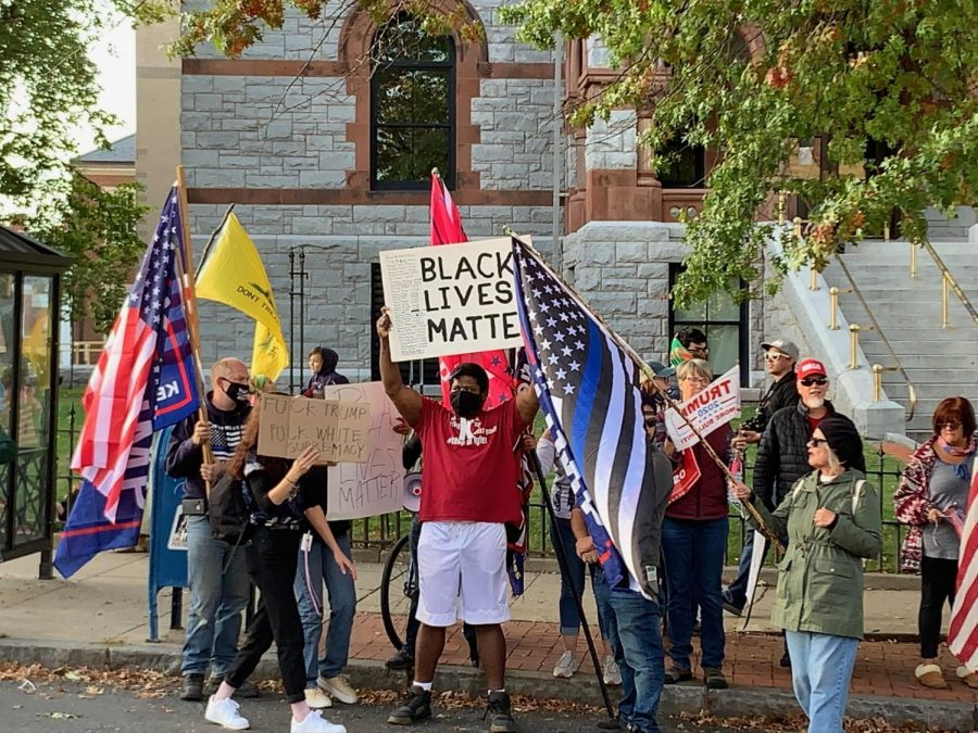 Black+Lives+Matter+supporter+in+the+middle+of+Trump+supporters+by+Tristan+Smith