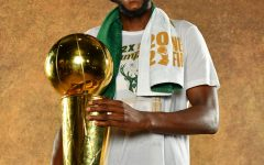 Khris Middleton holds the Larry O'Brien trophy. (Credit to the Bucks Twitter)