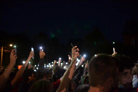 Protestor's flashlights by Abbie Gracie