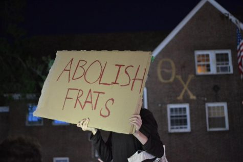 Protester in front of Theta Chi by Abbie Gracie
