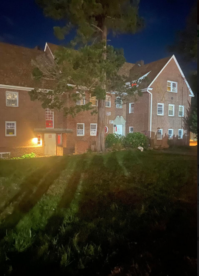 Shadows of protestors on the fraternity Theta Chis lawn during Monday nights protest.