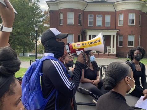 UMass NAACP E-Board member Bamidele Osinubi speaking to the crowd, by Tristan Smith