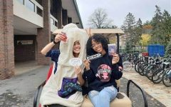 A couple of Players, one in a condom costume. The Players ride around campus occasionally in the golf cart to give out condoms and spread the word about sexual health and NRPB. Image from their Facebook.
